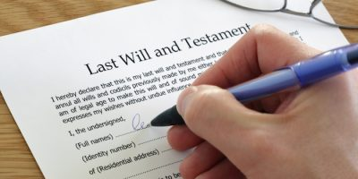 Signing Last Will and Testament document